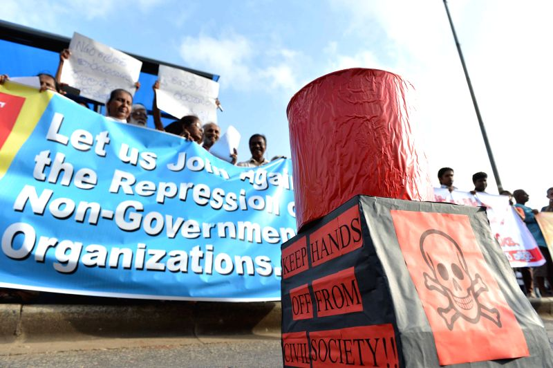 People attend a protest in Colombo, Sri Lanka, July 17, 2014. Dozens of members belonging to Non- Governmental Organizations (NGOs) protested in Sri Lanka's capital