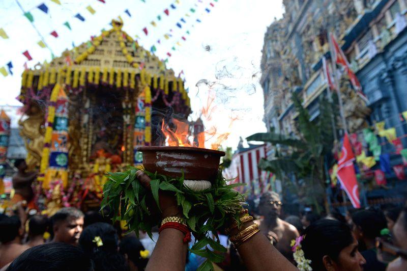 Sri Lankan Tamil Hindu devotees participate in the Vel Hinduism festival celebration in Colombo, on July 21, 2014.