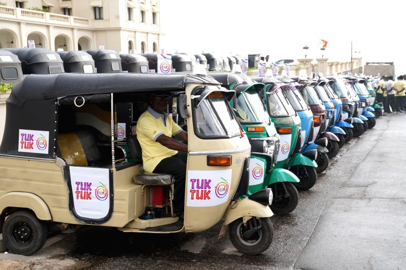 COLOMBO, July 30, 2018 - Tuk Tuk drivers gather at Galle Face Green in Colombo, Sri Lanka, July 30, 2018. The Sri Lankan government on Monday issued certificates, approved by the Sri Lanka Tourism ...