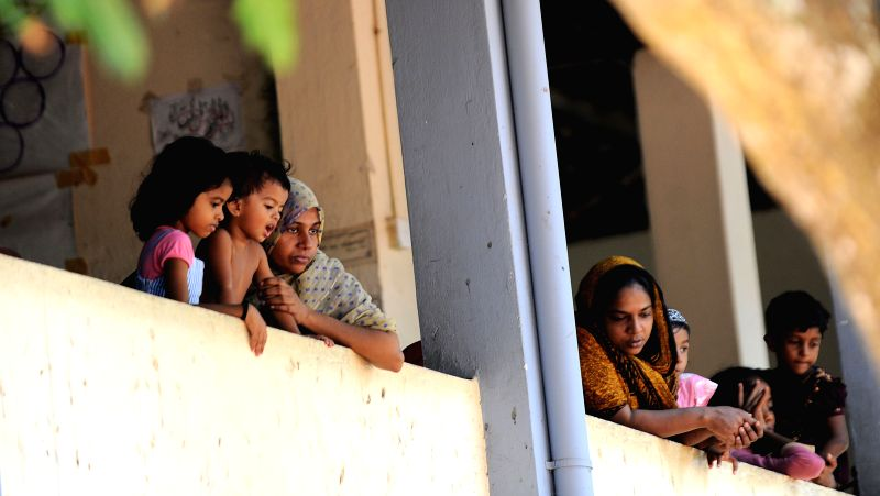Displaced Sri Lankan muslims rest at a makeshift camp in Beruwala, about 58 kms south of capital Colombo June 18, 2014. Police curfew was lifted in Sri Lanka's ...