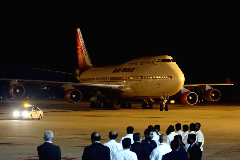 Photo taken on March 13, 2015 shows the plane carrying Indian Prime Minister Narendra Modi landing at Bandaranaike International Airport in Sri Lanka, March 13, ... - Narendra Modi