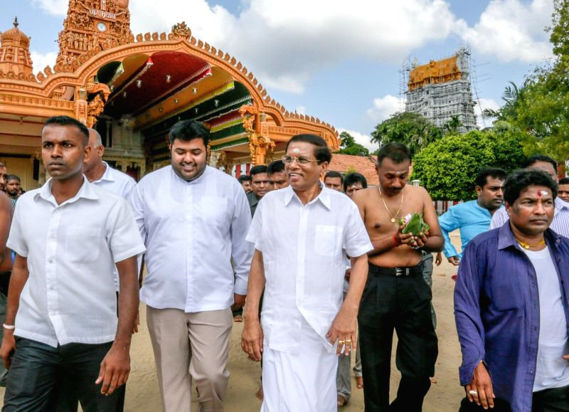 Sri Lanka's President Maithripala Sirisena (3rd L) visits the northern town of Jaffna in Sri Lanka, March 3, 2015. It was the new president's first visit to the ...