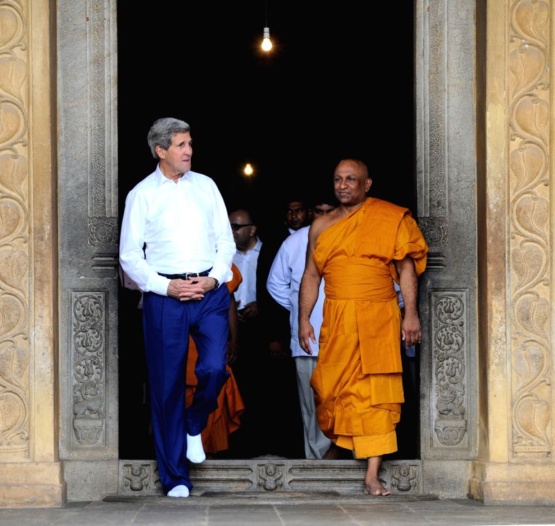 U.S. Secretary of State John Kerry (L) visits the Kelaniya Rajamaha Temple at Kelaniya in Colombo, Sri Lanka, May 2, 2015. John Kerry is on a two-day visit to Sri ...