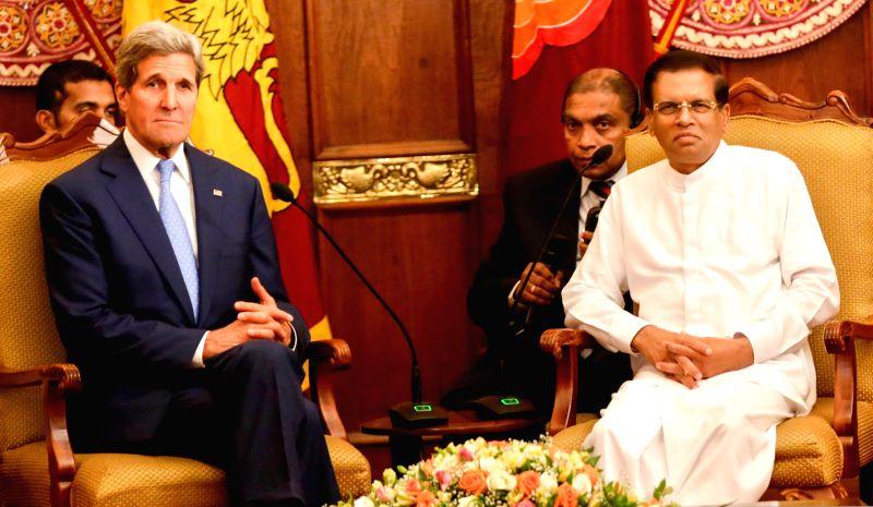 U.S. Secretary of State John Kerry (L, front) meets with Sri Lankan President Maithripala Sirisena (R, front) in Colombo, Sri Lanka, May 2, 2015. John Kerry is on a ...