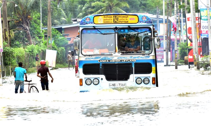 COLOMBO, May 30, 2017 - A bus runs on a flooded streent in Kaduwela, Sri Lanka, on May 29, 2017. Sri Lanka on Tuesday said that it was preparing to face health concerns once the floods which lashed ...