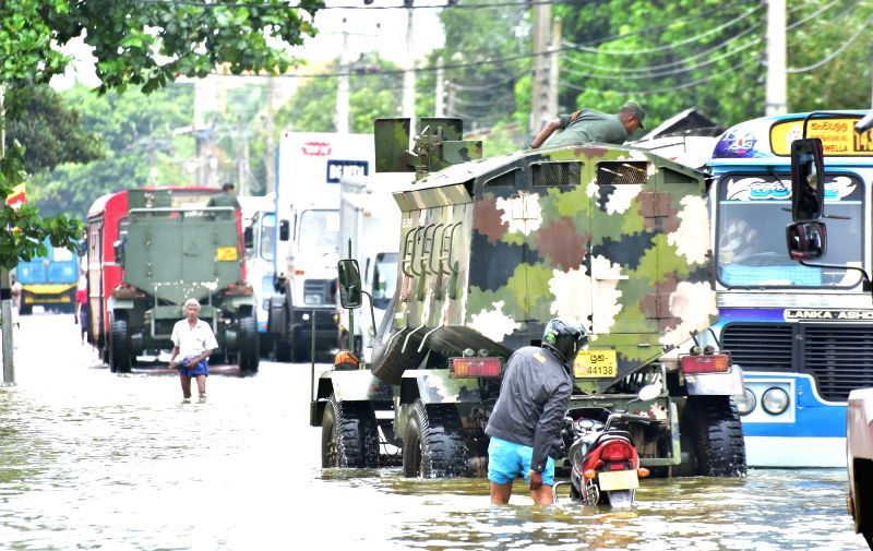 COLOMBO, May 30, 2017 - Rescue vehicles run on a flooded street in Kaduwela, Sri Lanka, on May 29, 2017. Sri Lanka on Tuesday said that it was preparing to face health concerns once the floods which ...