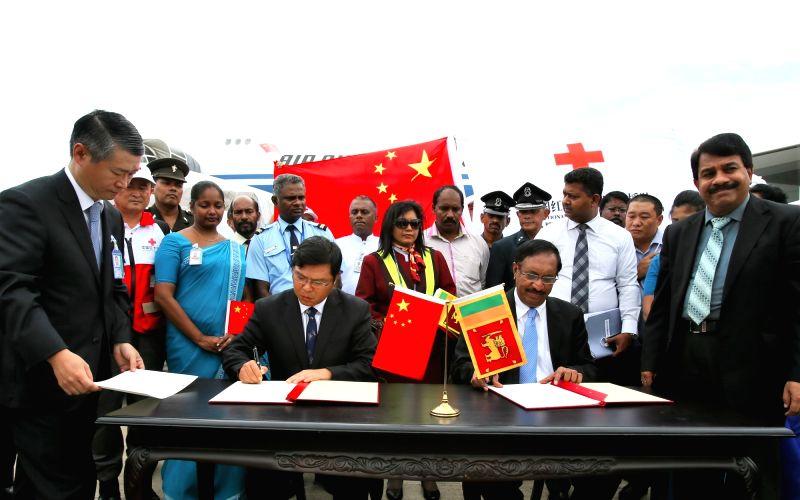 COLOMBO, May 31, 2016 - Chinese Ambassador to Sri Lanka Yi Xianliang (L, center) and Sri Lanka's Minister of Disaster Management Anura Priyadarshana Yapa (R, center) attend a handover ceremony in ...