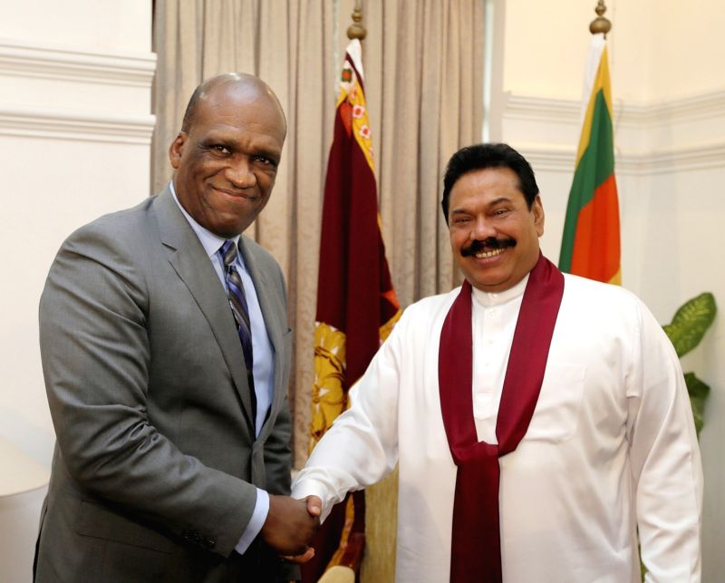 Sri Lankan President Mahinda Rajapaksa (R) meets with President of the United Nations General Assembly John William Ashe, who is in Colombo to attend the World ...