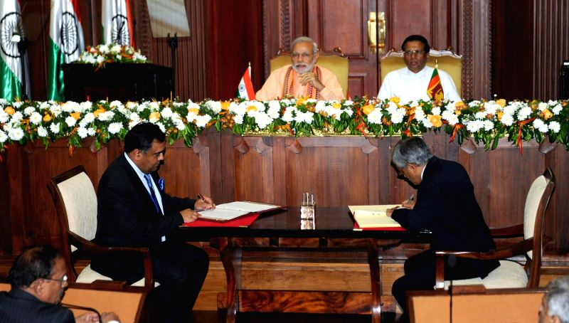 Prime Minister Narendra Modi and the Democratic Socialist Republic of Sri Lanka President Maithripala Sirisena witness the signing of agreements between India and Sri Lanka, in Colombo, Sri ... - Narendra Modi