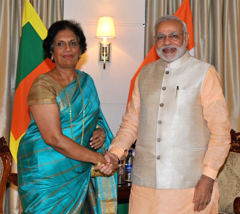 Prime Minister Narendra Modi meets Former Sri Lanka President Chandrika Kumaratunga in Colombo, Sri Lanka on March 13, 2015. - Narendra Modi