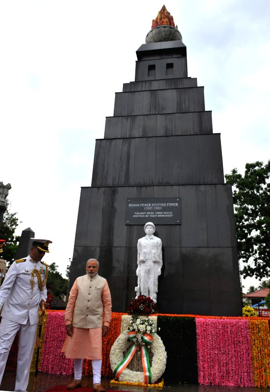 Prime Minister Narendra Modi pays tribute to the martyrs of the Indian Peace Keeping Force soldiers, in Colombo, Sri Lanka on March 13, 2015. - Narendra Modi