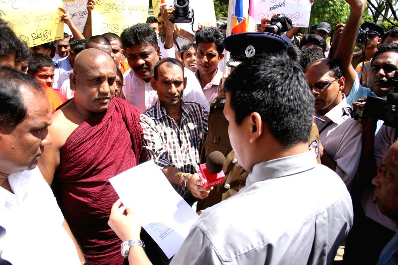 Protesters hand over a letter in Colombo, Sri Lanka, Sept. 3, 2014. A protest organized by state trade unions against Islamic State of Iraq and Syria (ISIS) was ...