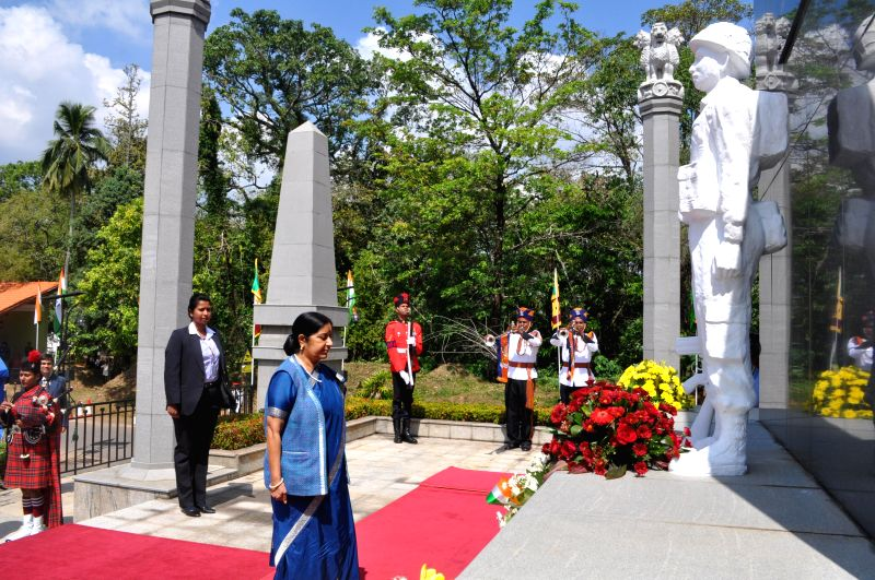 Union External Affairs Minister Sushma Swaraj pays homage at the Indian Peace Keeping Force (IPKF) Memorial in Colombo, Sri Lanka on March 7, 2015. - Sushma Swaraj
