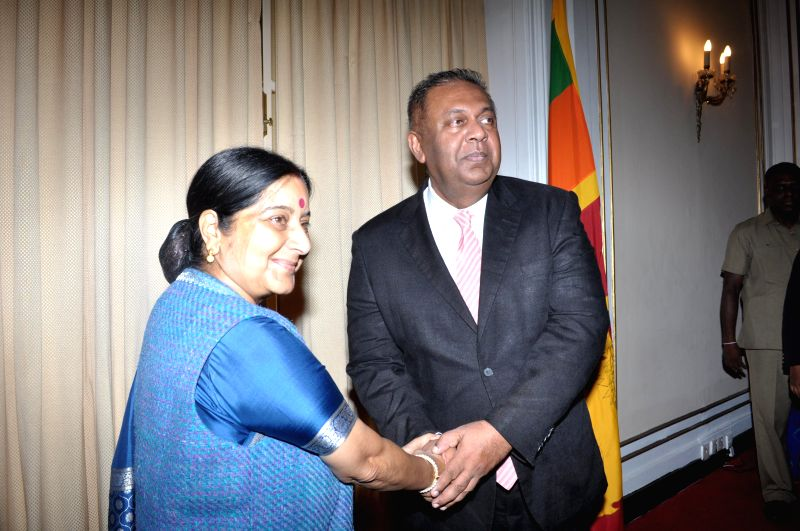 Union External Affairs Minister Sushma Swaraj interacts with the Sri Lankan Foreign Minister Mangala Samaraweera during a meeting  in Colombo, Sri Lanka on March 7, 2015.