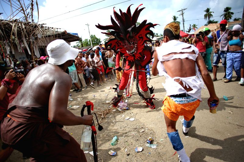 A dancer in devil costume takes part in the Ash Wednesday celebration at Nombre de Dios village, Colon province, Panama, on Feb. 18, 2015. The dance of the ...