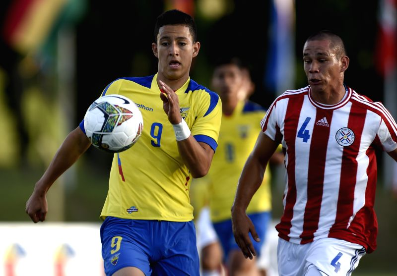 Ariel Benitez (R) of Paraguay vies with Miguel Parrales of Ecuador during a match at the South American U-20 tournament in Colonia, Uruguay, on Jan. 20, 2015. ...