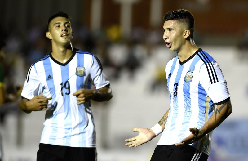 Argentina's Facundo Cardozo (R) celebrates during a match of the South American U-20 tournament against Bolivia in Colonia, Uruguay, on Jan. 22, 2015. ...