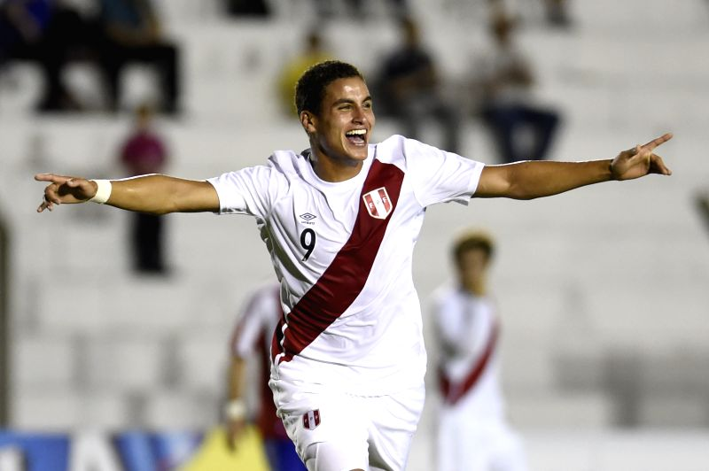 Peru's Alexander Succar celebrates during a match of the South American U-20 tournament against Paraguay in Colonia, Uruguay, on Jan. 22, 2015. (Xinhua/Nicolas ...