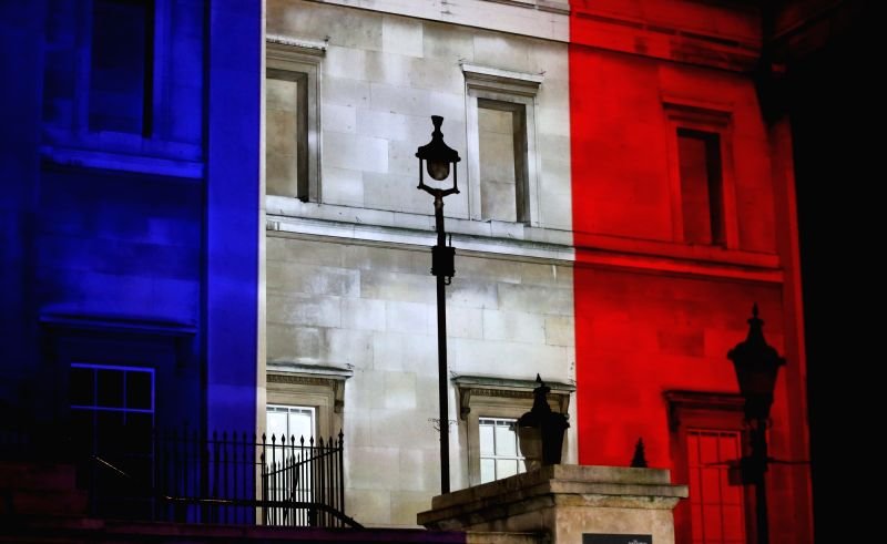 Colors that resemble the French national flag are seen on the National Gallery in London, Britain, on Nov. 14, 2015. The provisional death toll of Paris attacks is ...