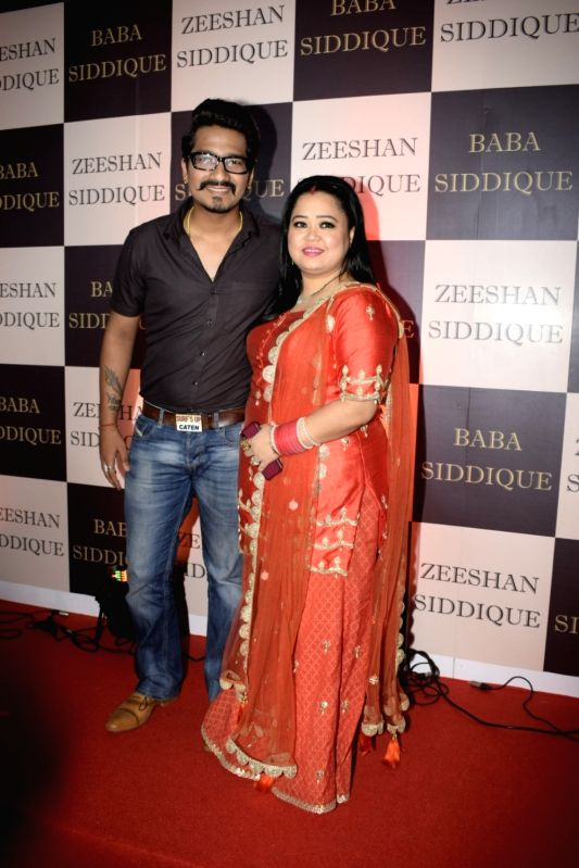 Comedian Bharti Singh along with her husband Haarsh Limbachiyaa at politician Baba Siddique's iftar party in Mumbai on June 10, 2018. - Bharti Singh