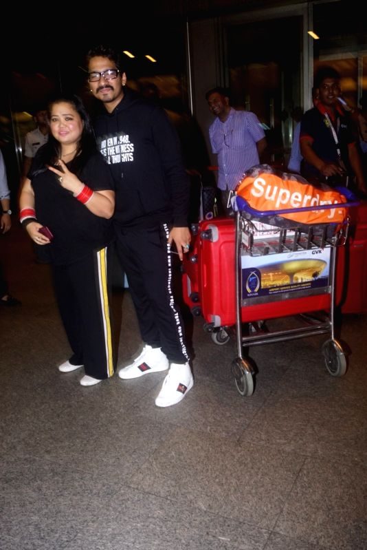 Comedian Bharti Singh with her husband Haarsh Limbachiyaa leave for Argentina to begin shooting for Khatron Ke Khiladi season 9 in Mumbai on July 11, 2018. - Bharti Singh