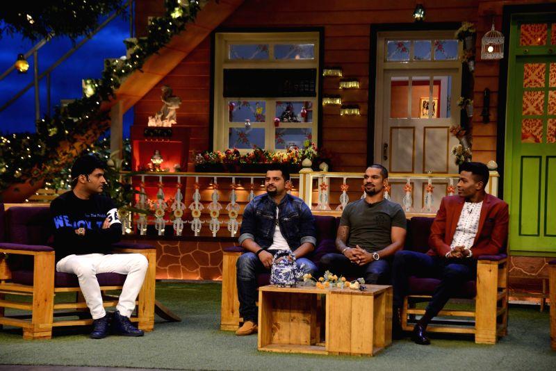 Comedian Kapil Sharma, Indian cricket players Suresh Raina, Shikhar Dhawan and Hardik Pandya on the sets of The Kapil Sharma Show in Mumbai,on May 23, 2017. - Shikhar Dhawan and Kapil Sharma