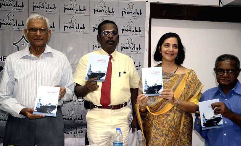 Commander G S Parmar, Captain Lawrence, Meera Saniyal and Mrityunjay Bose during launch of `IMS Vikrant` - a book, in Mumbai on July 16, 2014. - Lawrence and Mrityunjay Bose