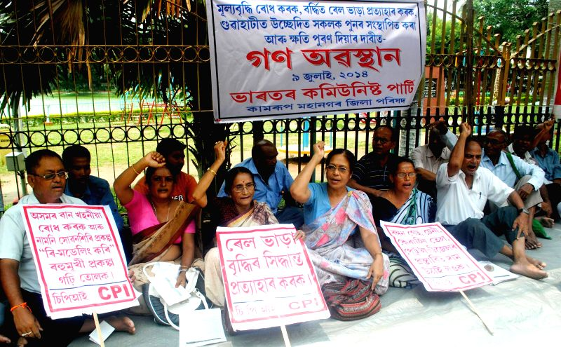 Communist Party of India (CPI) activists demonstrate against hike in prices of essential commodities and other issues in Guwahati on July 9, 2014.
