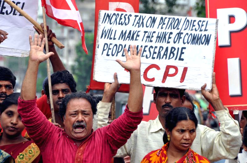 Communist Party of India (CPI) workers demonstrate against hike in fuel prices in Bhubaneswar on June 19, 2014. (Photo : Arabinda Mahapatra/IANS)