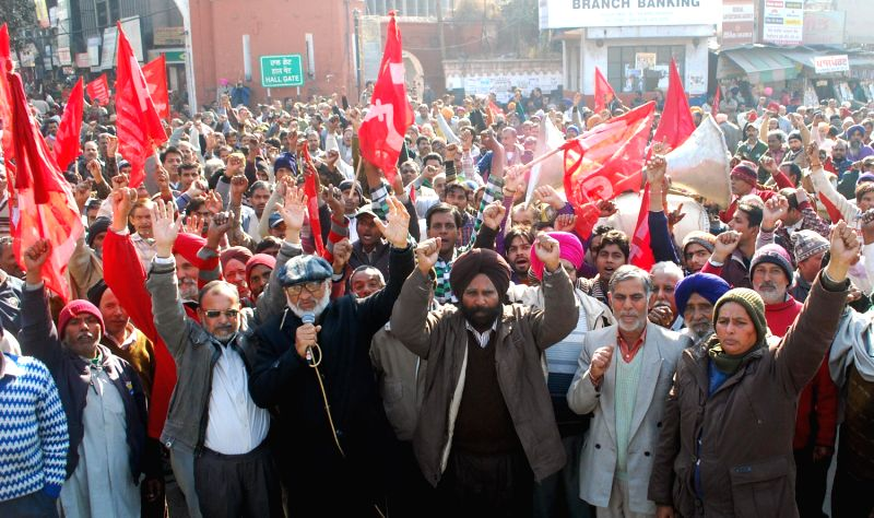 Communist Party of India-Marxist (CPI-M) activists demonstrate to protest against Punjab Government and to press for various issues in Amritsar on Jan.3, 2014.