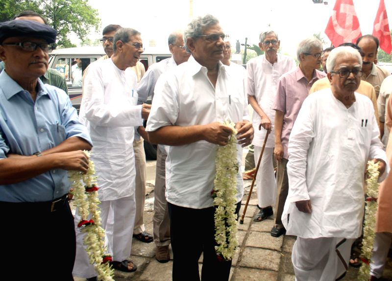 Communist Party of India-Marxist (CPI-M) leader Sitaram Yechury, Left Front chairman Biman Bose and other Left Front leaders during 197th birth anniversary celebrations of  Karl Marx in Kolkata on ... - Sitaram Yechury and Biman Bose