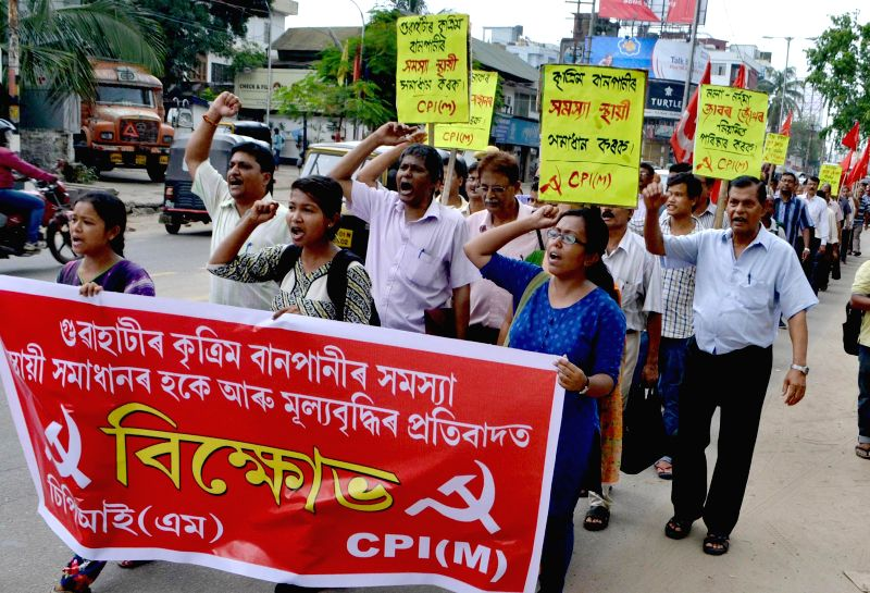 Communist Party of India (Marxist) workers participate in a rally to protest against hike in prices of essential commodities in Guwahati on July 3, 2014.