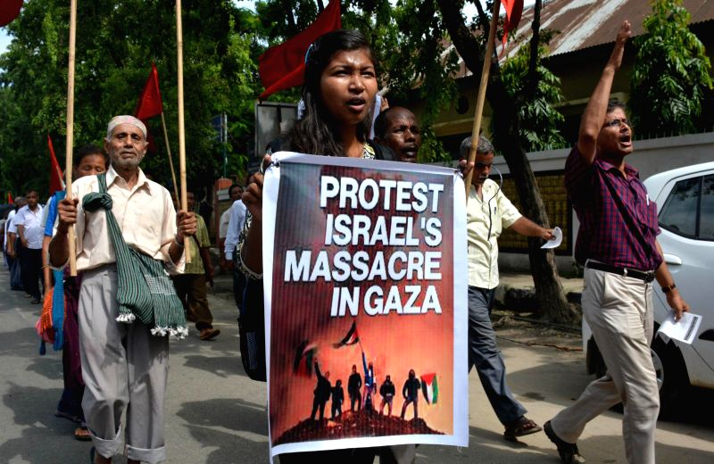 Communist Party of India (Marxist) workers participate in a rally organised to protest against Israeli attacks on Gaza in Guwahati on July 19, 2014.