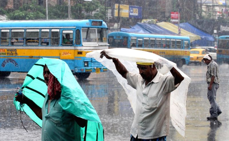 Commuters during rains, in Kolkata on July 31, 2018.