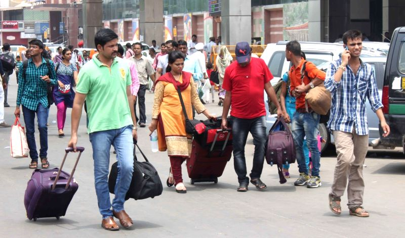 Commuters stranded at Nizamuddin Railway Station as stayed off the roads after their unions called a strike against the government policy to allow app-based auto and taxi services to ...