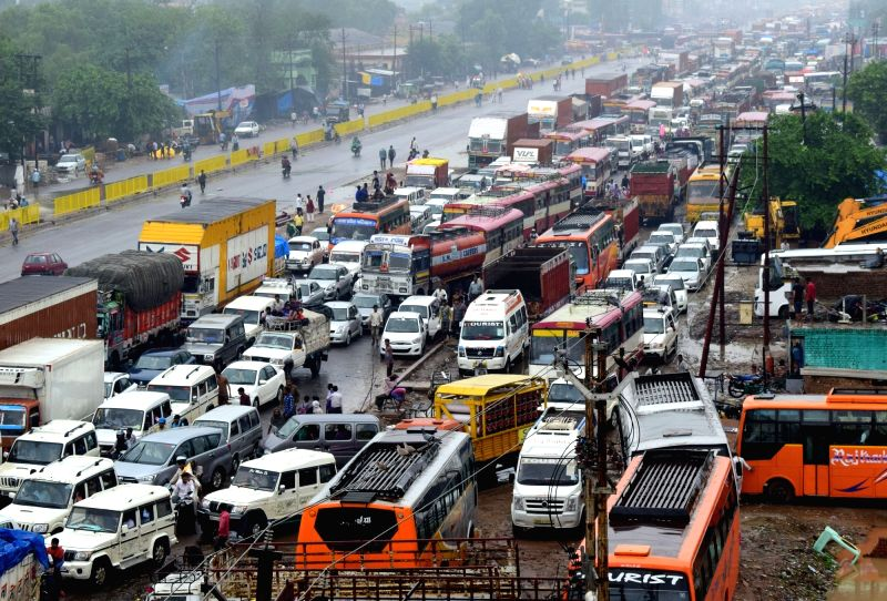 Commuters stuck in a massive traffic jam after heavy rains on NH-2, in Mathura, on July 27, 2018.