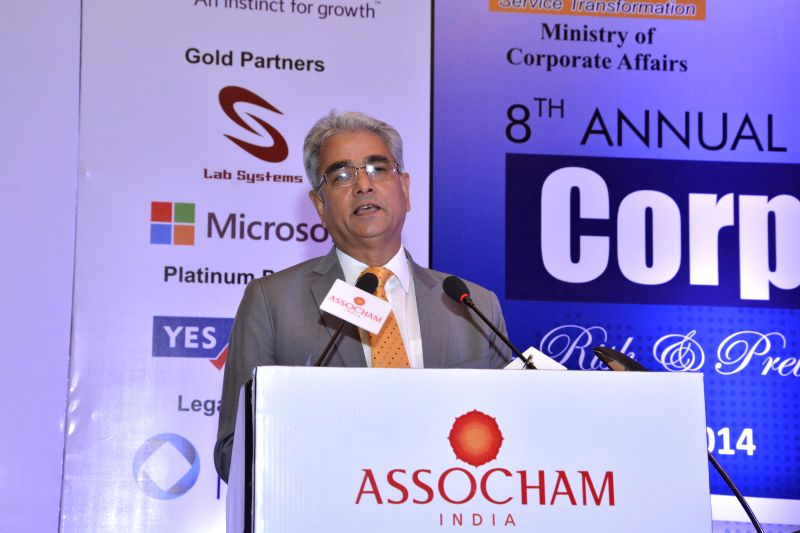 Comptroller and Auditor General of India Shashi Kant Sharma addresses during 8th annual summit on corporate frauds in New Delhi on May 13, 2014. - Shashi Kant Sharma