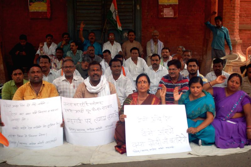 Congres activest protest against rail fare hike in Varanasi on June 21, 2014.