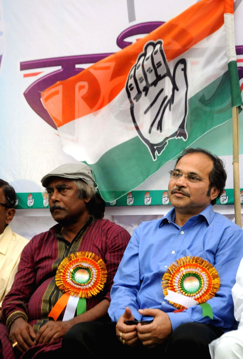 Congress candidate for 2014 Lok Sabha Election from Jadavpur parliamentary constituency, famed painter Samir Aich with party leader Adhir Ranjan Chowdhury during an election campaign in Kolkata on ...