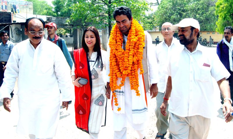 Congress candidate for 2014 Lok Sabha Election from Phulpur Lok Sabha seat Mohammad Kaif arrives to file his nomination papers in Allahabad on April 15, 2014.