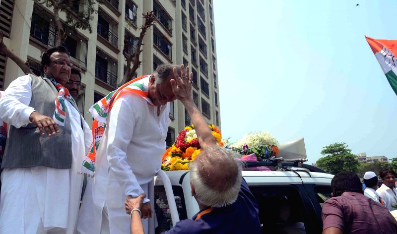 Congress candidate for 2014 Lok Sabha Election from Mumbai North West, Gurudas Kamat during an election campaign in Mumbai on April 18, 2014.