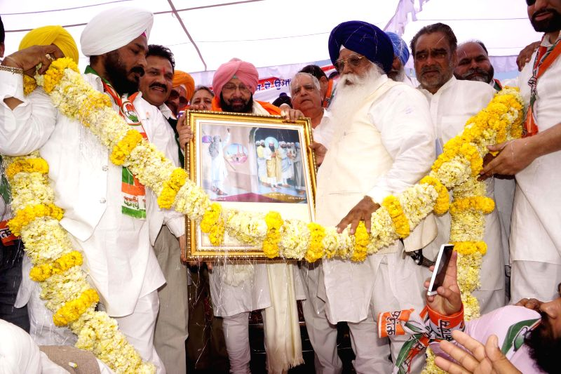 Congress candidate for 2014 Lok Sabha Election from Amritsar, Captain Amarinder Singh during an election campaign in Verka near Amritsar on April 20, 2014.