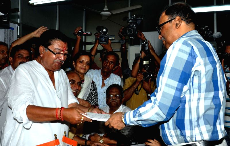 Congress candidate for 2014 Lok Sabha Election from North Kolkata parliamentary constituency Somen Mitra files his nomination papers in Kolkata on April 21, 2014.