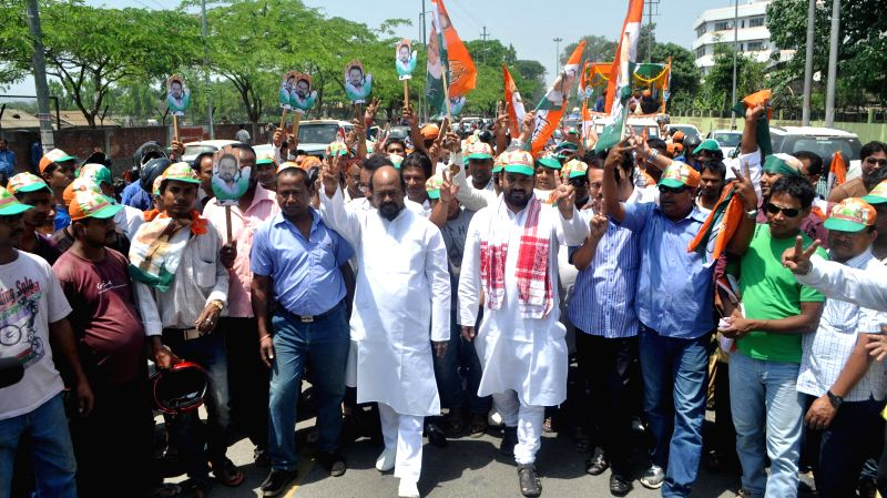 Congress candidate for 2014 Lok Sabha Election from Guwahati, Manash Bora during a roadshow with his father Akon Bora in Guwahati on April 22, 2014.