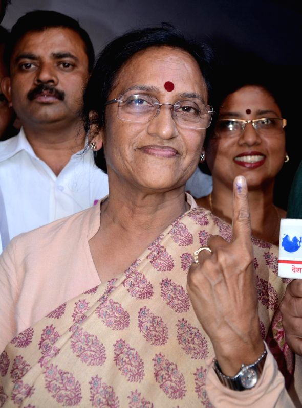 Congress candidate for 2014 Lok Sabha Election from Lucknow parliamentary seat, Rita Bahuguna Joshi shows her fore finger marked with phosphorous ink after casting her vote at a polling booth during .