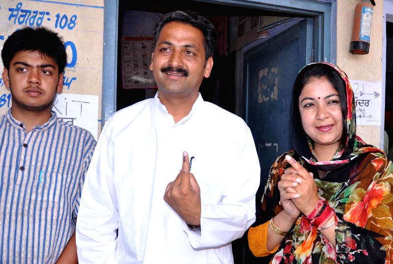 Congress candidate for 2014 Lok Sabha Election from Sangrur parliamentary constituency,Vijay Inder Singla shows his fore finger marked with phosphorous ink after casting his vote at a polling booth ..