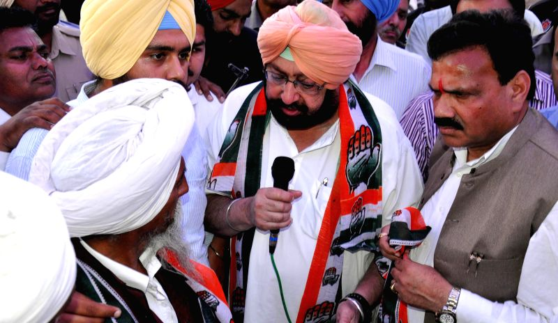 Congress candidate for upcoming 2014 Lok Sabha Election from Amritsar, Captain Amarinder Singh during an election campaign in Amritsar on April 10, 2014.