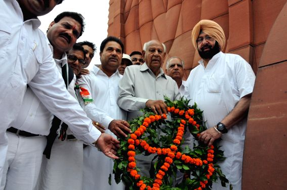 Congress candidate for upcoming 2014 Lok Sabha Election from Amritsar, Captain Amarinder Singh pays tribute to the martyrs on the eve of Baisakhi at Jallianwala Bagh in Amritsar on April 13, 2014.