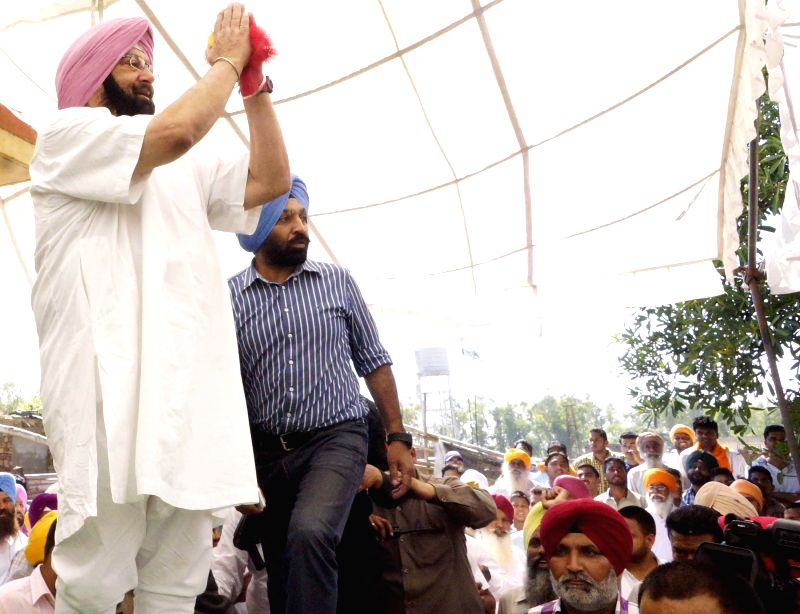 Congress candidate from Amritsar, Capt. Amarinder Singh addressing during a rally at Rajasansi near Amritsar on April 19, 2014.