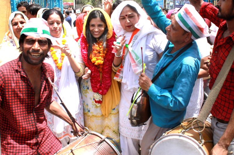 Congress candidate Yogita Rathi who won from the all-women candidate ward Munirka in the the recently concluded Municipal Corporation of Delhi (MCD) by-polls celebrates her victory in New ...